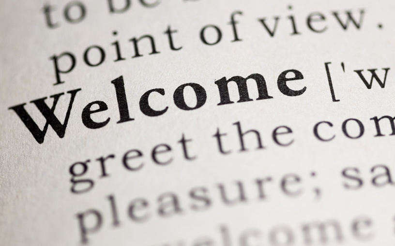 Dictionary open to definition of welcome
